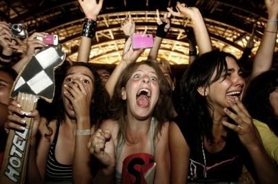 Fans of German rock band Tokio Hotel scream during a concert in Lisbon